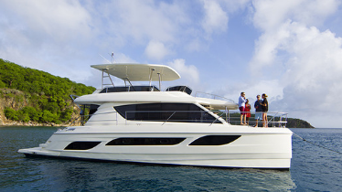 Boat on the water with people on the stern